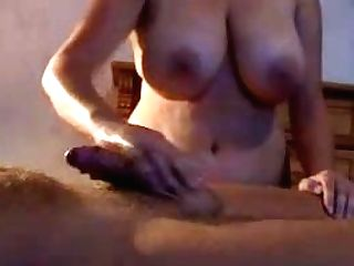 Big Titted Mummy Gives A Cock Stroking