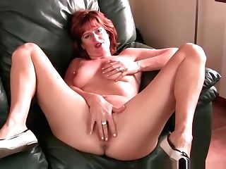Redheaded Matures Mom Plays With Her Nips And Puss
